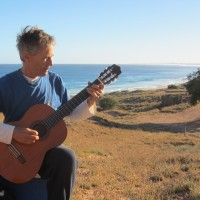 Gordon playing guitar at Red Bluff